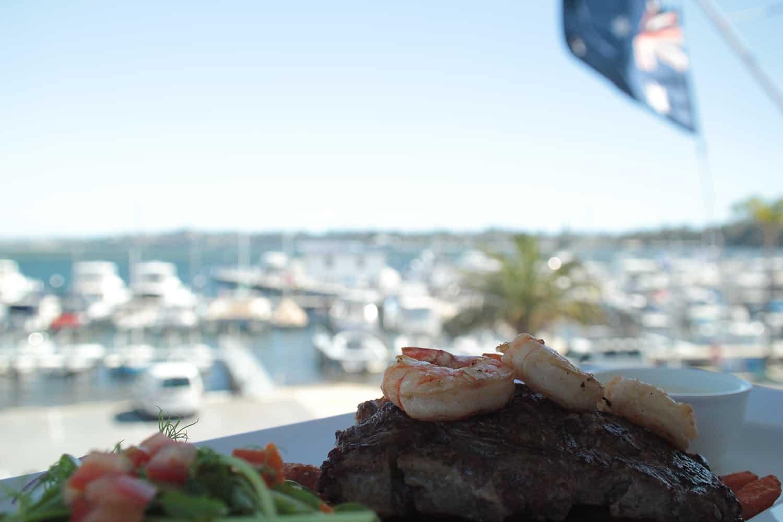 Steak & Prawn dinner overlooking Freshwater bay